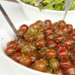 Stock Photo: Israely Sherry tomato Salad with olive oil,sesame and herbs