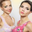 Two girls with colored make-up — Stockfoto
