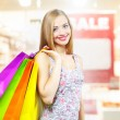Stylish Girl with shopping bags - Stock Photo