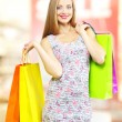 Happy girl with shopping bags — Stok fotoğraf