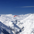 Stok fotoğraf: Sky gliding in snowy mountains