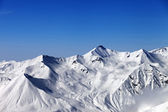 Snowy mountains and blue sky — Stock Photo