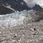 Hiker on glacier moraine — Stock Photo