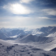 Snowy mountains in evening — Stock Photo