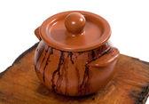 Dirty ceramic pot on old wooden kitchen board — Stok fotoğraf