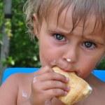 Child eating melting ice-cream — Stock Photo
