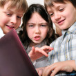 Group of children friends playing studying at laptop — Stock Photo