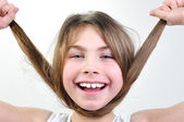 Funny girl playing with her hair — Stock Photo