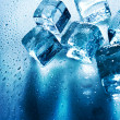 Ice cubes over wet backgrounds with back light — Stock Photo