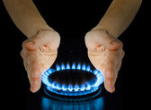 Blue gas in hands on the black — Stock Photo