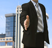 Man with an open hand ready to seal a deal — Stock Photo