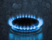 Gas stove burner with blue flame — Stock Photo