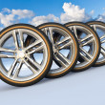 Set of car wheels in snowy landscape — Stock Photo #11032233