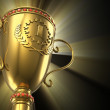 Golden glowing trophy cup on black background — Stock Photo