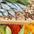 Fish with bay leaves and spice - Stock Photo