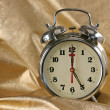 Metallic ld-fashioned alarm-clock - Stock Photo
