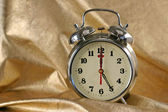 Metallic ld-fashioned alarm-clock — Stock Photo