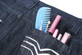 Cosmetics in jeans pocket — Stock Photo