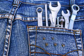 Tools in jeans pocket — Stockfoto