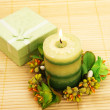 Candle and present box — Stock Photo