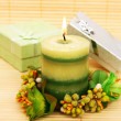 Stock Photo: Candle and present boxes
