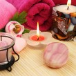 Towels, soap, flowers, candles - Stock Photo