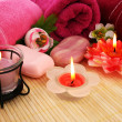 Towels, soap, flowers, candles — Stock Photo