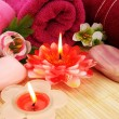 Towels, soap, flowers, candles — Stock Photo #10744769