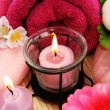 Towels, soap, flowers, candles — Stock Photo #10744795
