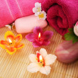 Towels, soap, flowers, candles — Stock Photo #10744822