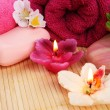 Towels, soap, flowers, candles — Stock Photo #10744835