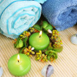 Towels, candles and stones — Stock Photo #10745848