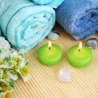 Towels, candles and stones — Stock Photo #10745908