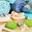 Towels, soaps, flowers, candles — Stock Photo #10746396