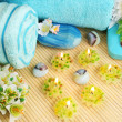 Towels, soaps, flowers, candles — Stock Photo #10746603