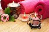 Towels, soap, flower, candles — Stock Photo