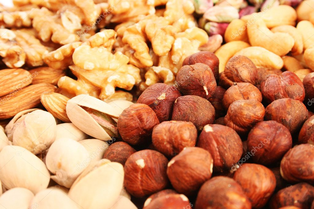Different nuts as a background. — Stock Photo #10763261