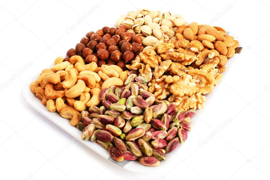 Different nuts isolated on white  background. — Stock Photo #10763292
