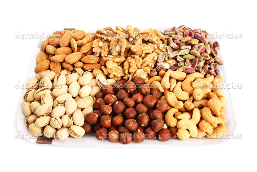 Different nuts isolated on white  background.  Stock Photo #10763374