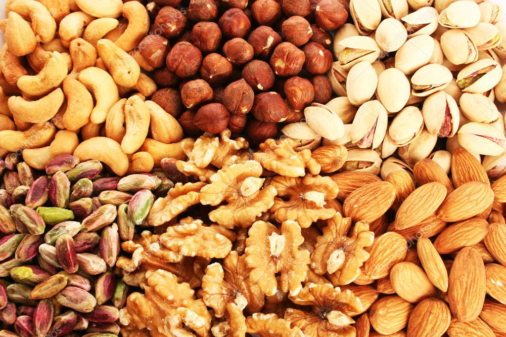 Different nuts as a background. — ストック写真 #10763451