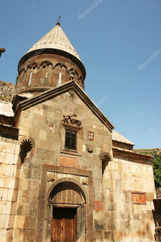 Geghard monastery in Armenia, unique architectural construction, being partially carved out of the adjacent mountain, surrounded by cliffs. UNESCO World Heritage Site,the monastery complex was founded in the 4th century. — Stock Photo #10764813
