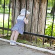 Little girl near fence — Stock Photo #11109335