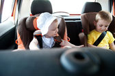 Children travelling in car — Photo