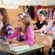 Schoolchildren at classroom during a lesson — Stock Photo #11692269