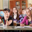 Schoolchildren at classroom during a lesson - Stockfoto