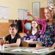 Smiling girl in classroom at school — Stockfoto
