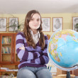 Royalty-Free Stock Photo: Pretty girl with globe in classroom