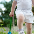 Little child walking in green grass — Stock Photo