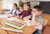 Schoolchildren at classroom during a lesson — Foto Stock