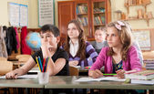 Schoolchildren at classroom during a lesson — Stock Photo